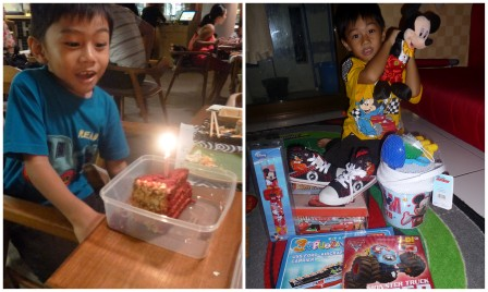 the birthday boy with his cake and presents!